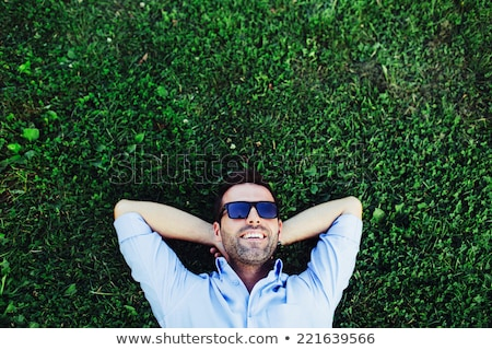 casual man outdoor with hand at head stock photo © feedough