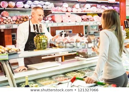 Hentes friss kolbász bolt kép mosolyog Stock fotó © Kzenon