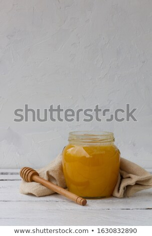 Bee pollen in glass pot and wooden spoon Stock photo © marimorena