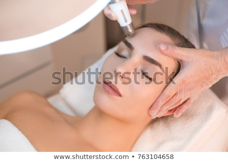 Woman Having Skin Rejuvenating Laser Treatment In Clinic Stock photo © HighwayStarz