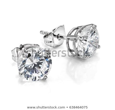 Fashion earrings on white background Stock photo © Lizard