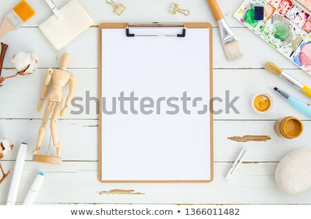 Wooden manikin and colour pencil on artist work table Stock photo © nalinratphi
