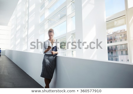 Stock photo: Businesswoman lawyer using digital tablet app