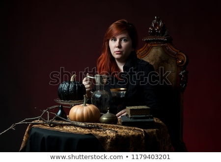portrait of young woman with a glass of red wine and carafe Stock photo © phbcz