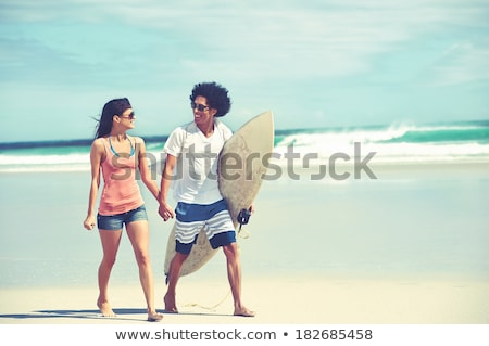 Latino young man with a surf board Stock photo © iko