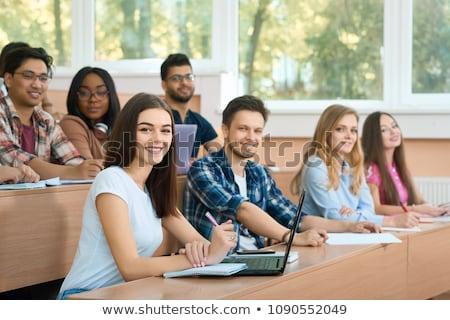 Gruppe · lächelnd · Studenten · Sitzung · zusammen · ein - stock foto © lightpoet