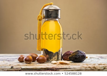 Bottle of Argan oil and fruits stock photo © Luisapuccini