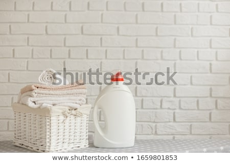 Folded Clean Clothes in a White Plastic Basket Stock photo © ozgur