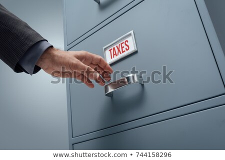 a drawer cabinet with the label revenue stock photo © zerbor