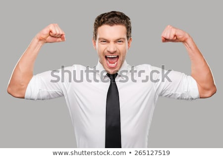 Handsome man showing fist at camera Stock photo © deandrobot