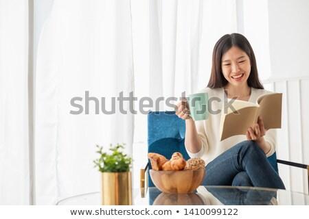 attractive girl sitting on sofa drinking tea stock photo © nyul
