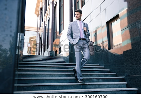 young businessman walks stock photo © paha_l