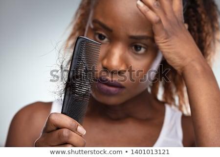 Vrouw lijden portret jonge vrouw haren triest Stockfoto © AndreyPopov