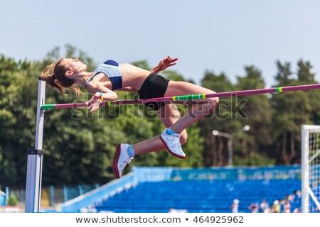 Mulher jovem mulheres reunião saltar jovem sucesso Foto stock © OleksandrO