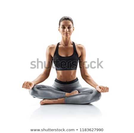 flexible young woman doing stretching yoga exercises stock photo © deandrobot
