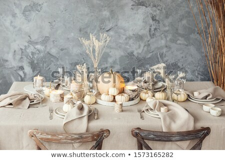 Dinnerware setting for autumn Thanksgiving holiday on rustic woo Stock photo © tab62
