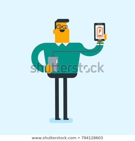 man · smartphone · draagbaar · batterij · jonge · kaukasisch - stockfoto © rastudio