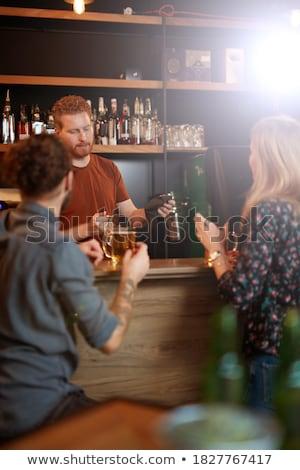 Paar glas bier counter restaurant romantische Stockfoto © wavebreak_media