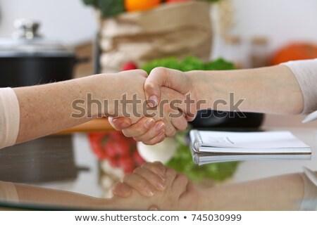Vrienden handen schudden maaltijd restaurant business wijn Stockfoto © wavebreak_media