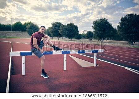 Konsantre genç spor adam oturma stadyum Stok fotoğraf © deandrobot