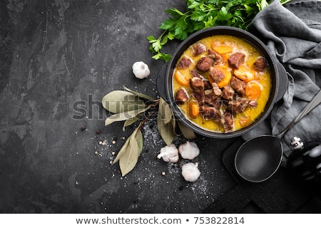 Meat stew, goulash in a cast iron pot, top view Stock photo © yelenayemchuk