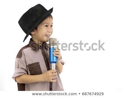 Asian little boy singing into a microphone. Stock photo © RAStudio