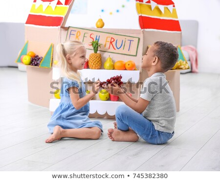 Girls playing with fruit Stock photo © IS2