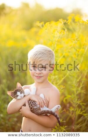 Portrait of little boy bringing a kitten Stock photo © wavebreak_media