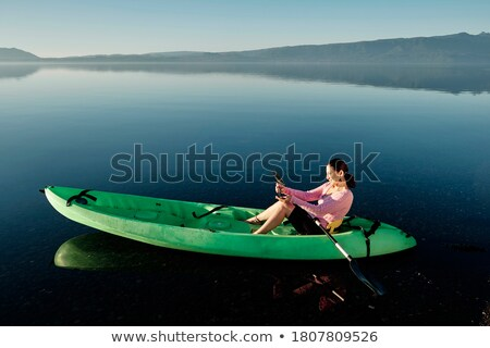 woman taking a beautiful lake picture with her smart phone stock photo © feverpitch