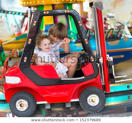 Stock photo: Brother and sister on a fairground ride