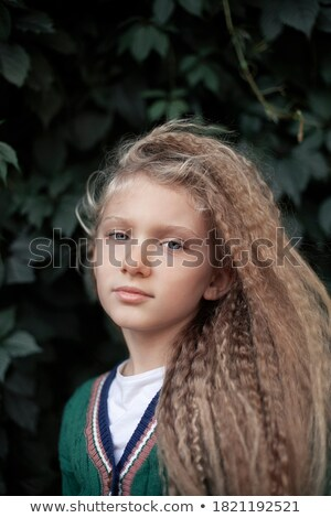 Young girl against hedge Stock photo © IS2
