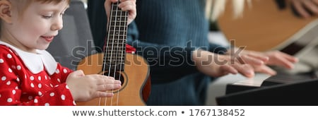 Parents listening to daughter play piano Stock photo © IS2