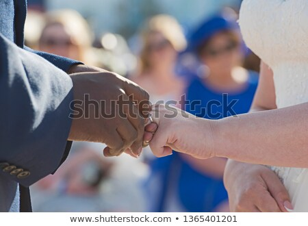 bride and groom wedding ring. Caucasian and African people Stock photo © studiostoks