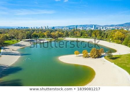 puesta · de · sol · río · siluetas · grúa · puerto · naranja - foto stock © xbrchx