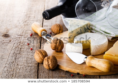 table with various food served with red wine stock photo © dashapetrenko