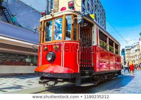 Retro tram on cityscape background Stock photo © jossdiim