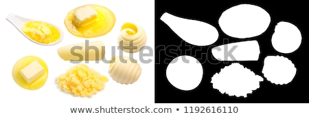 Melted butter piece floating, top view Stock photo © maxsol7