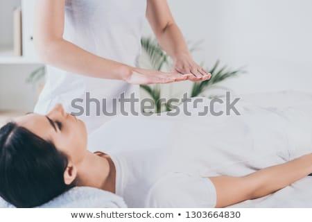 Młoda kobieta reiki leczenie terapeuta Zdjęcia stock © AndreyPopov