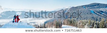 Boldog férfi hódeszka hegyek kiemelt fölött Stock fotó © Anna_Om