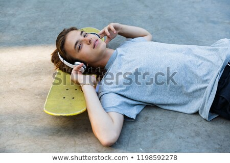 cute young guy spending time at the skate park stock photo © deandrobot