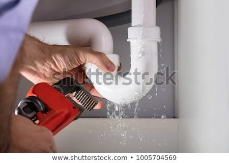 Férfi vízvezetékszerelő megjavít vízcsap konyha fiatal nő Stock fotó © AndreyPopov