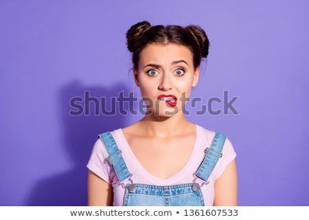 Close up of an upset young woman wearing t-shirt Stock photo © deandrobot