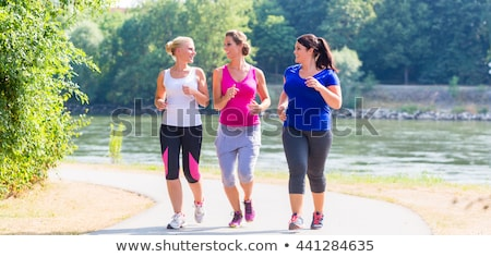 young woman running outdoor by river stock photo © boggy