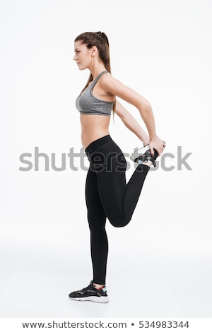 Side view portrait of a smiling young fitness girl Stock photo © deandrobot