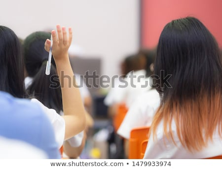 Students rising hands to answer the question during the workshop Stock photo © boggy