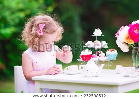 little girl playing with toy tea set at home Stock photo © dolgachov