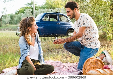 man giving woman engagement ring on valentines day Stock photo © dolgachov