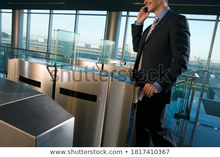 Mid section of business people discussing on mobile phone in restaurant Stock photo © wavebreak_media