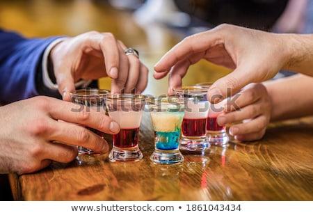 друзей питьевой текила таблице ночном клубе женщину Сток-фото © wavebreak_media