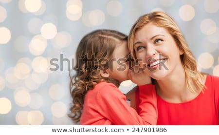 happy daughter whispering secret to her mother Stock photo © dolgachov